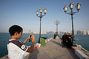 Panoramic view of the Corniche from the Breakwater. Locals taking souvenir photos.