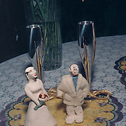 Funny clay statues of the bride and groom,