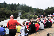 New Zealand, North Island, Rotorua, The Te Puia Geothermal Cultural Experience, Pohutu Geyser Tourists await the eruption
