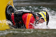"""Jud Kaiser of Liberty Lake, Washington prepares to front flip out of the water at the popular kayaking spot """"Dead Dog"""" along the Spokane River near Stateline, Idaho on Wednesday."""