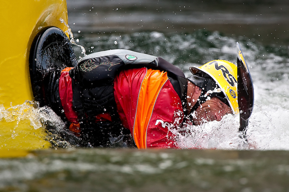 "Jud Kaiser of Liberty Lake, Washington prepares to front flip out of the water at the popular kayaking spot ""Dead Dog"" along the Spokane River near Stateline, Idaho on Wednesday."