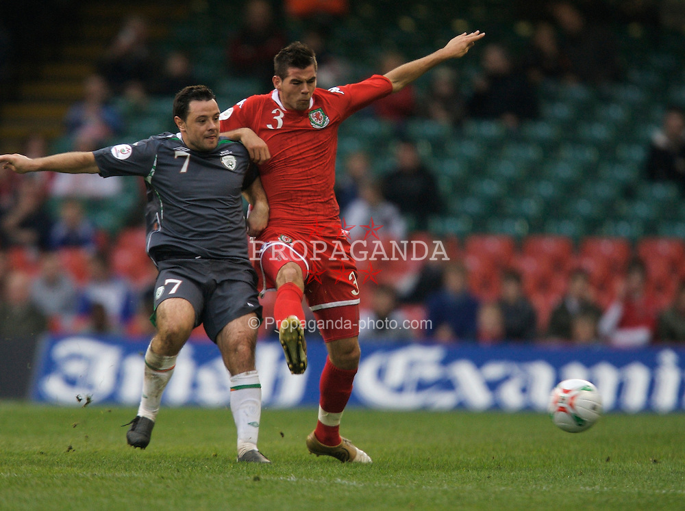 CARDIFF, WALES - Saturday, November 17, 2007: Wales' Joe Ledley and Republic of Ireland's Andy Reid during the UEFA Euro 2008 Qualifying Group D match at the Millennium Stadium. (Pic by David Rawcliffe/Propaganda)