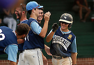 Souderton's David Schreffler is congratulated after scoring a run against Pennridge in the second inning at Quakertown Memorial Park Monday July 13, 2015 in Quakertown, Pennsylvania.  (Photo by William Thomas Cain)