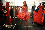 A model wears a dress created from SUBWAY wrappers at the Go Red For Women The Heart Truth Red Dress Collection 2014, made possible by Macy's and SUBWAY Restaurants, Thursday, Feb. 6, 2014, during Fashion Week in New York.  (Photo by Diane Bondareff for Go Red For Women)