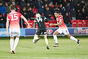 Salford City defender Ibou Touray challenges Macclesfield Town midfielder Connor Kirby  during the EFL Sky Bet League 2 match between Salford City and Macclesfield Town at the Peninsula Stadium, Salford, United Kingdom on 23 November 2019.