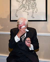 © Licensed to London News Pictures. 25/08/2015. London, UK. Ex-Tory MP Harvey Proctor wiping sweat from his forehead during a press conference in central London after he was interviewed by police for a second time yesterday about a VIP child abuse probe. Photo credit: Ben Cawthra/LNP