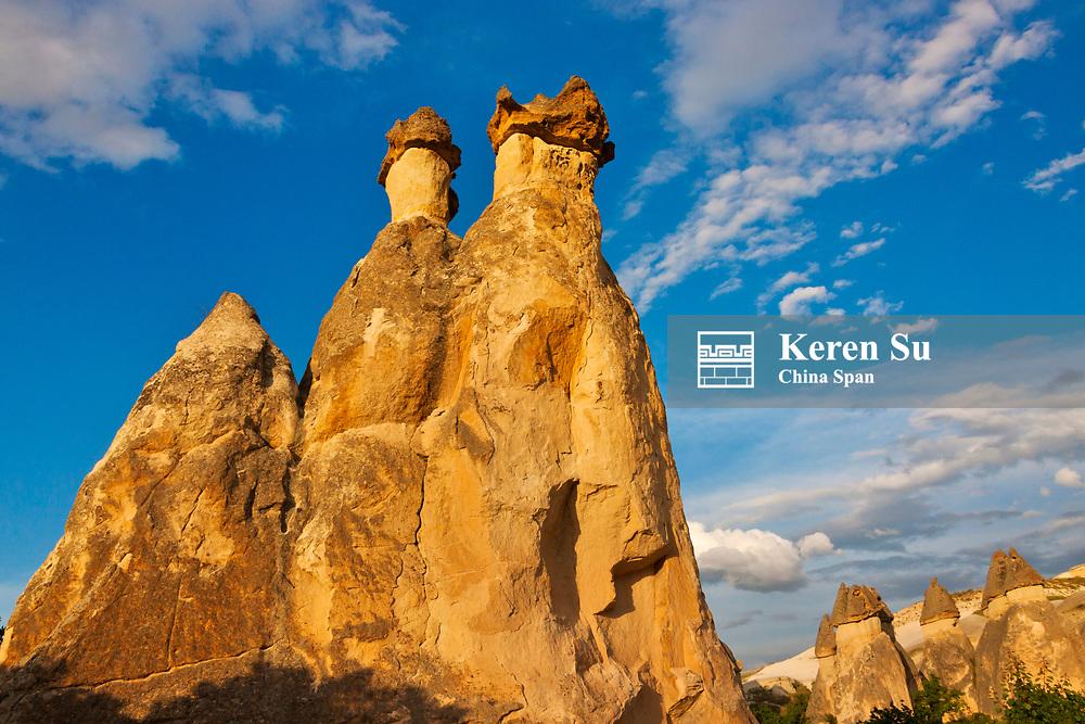 Fairy chimney rock formation in Goreme at sunset, Cappadocia, Turkey