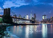 Brooklyn Bridge and downtown Manhattan lit up at night, New York City.