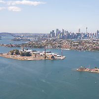 View of Cockatoo Island and Sydney city with Harbour Bridge from above.