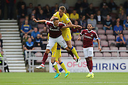 AFC Wimbledon defender Paul Robinson (6) and Northampton Town striker Alex Revell (10) tussle during the EFL Sky Bet League 1 match between Northampton Town and AFC Wimbledon at Sixfields Stadium, Northampton, England on 20 August 2016. Photo by Stuart Butcher.