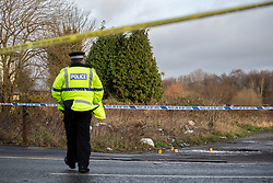 © Licensed to London News Pictures . 29/12/2018 . Wigan , UK . Police forensic markers at the scene where they have taped off a stretch of Bickershaw Lane in Abram . GMP report they have arrested two people on suspicion of attempted murder and for conspiracy to commit attempted murder , respectively , after a 21-year-old man sustained life-threatening injuries yesterday evening (Friday 28th December 2018) . Photo credit : Joel Goodman/LNP
