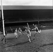 27/03/1966<br /> 03/27/1966<br /> 27 March 1966<br /> National Hurling League, Division II: Antrim v Kerry at Croke Park, Dublin. <br /> Antrim goalie, D. O'Neill, comes out of his goalmouth to catch the ball. He missed and the ball went inside the net. (Kerry full-forward on the left.)