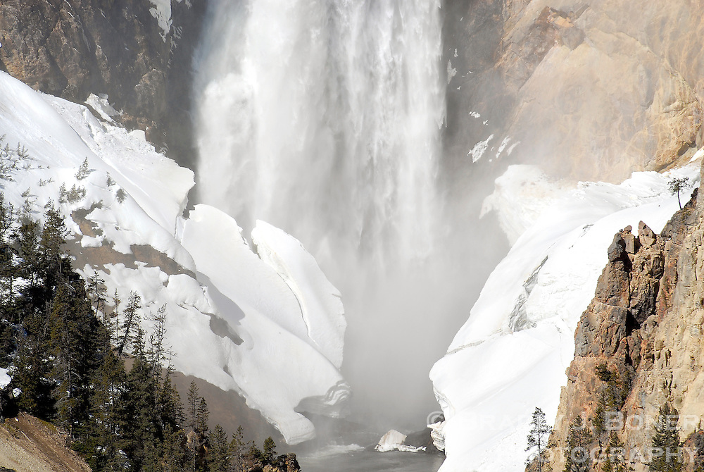 NEWS&GUIDE PHOTO / BRADLY J. BONER.The mass of ice and snow at the base of the Lower Falls in the Grand Canyon of the Yellowstone begins to break apart as on Saturday morning. Park officials opened a limited number of roads in Yellowstone on Friday.