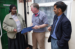 A group of people involved in development partnership working; handing over the keys to new tenant,