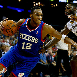 Nov 16, 2013; New Orleans, LA, USA; Philadelphia 76ers small forward Evan Turner (12) drives past New Orleans Pelicans point guard Tyreke Evans (1) during the first half of a game at New Orleans Arena. Mandatory Credit: Derick E. Hingle-USA TODAY Sports