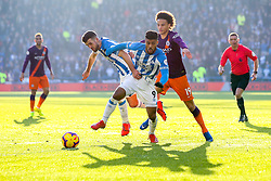 Leroy Sane of Manchester City takes on Elias Kachunga and Tommy Smith of Huddersfield Town - Mandatory by-line: Robbie Stephenson/JMP - 20/01/2019 - FOOTBALL - The John Smith's Stadium - Huddersfield, England - Huddersfield Town v Manchester City - Premier League