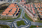 Nederland, Zuid-Holland, Pijnacker, 20-03-2009; rotondes ontsluiten de nieuwe wijken in in Pijnacker-Zuid en maken woon-werkverkeer mogelijk. New housing estates of the village of Pijnacker, between the motorways. In the foreground newly constructed roads and roundabouts..Swart collectie, luchtfoto (toeslag); Swart Collection, aerial photo (additional fee required); .foto Siebe Swart / photo Siebe Swart