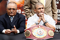September 10, 2009; Bronx, NY; USA; Miguel Cotto Sr. (l) and Miguel Cotto (r) at the press conference at Yankee Stadium announcing Miguel Cotto's November 14th, 2009 fight against Manny Pacquiao.  The two will meet at the MGM Grand Garden Arena in Las Vegas, NV.