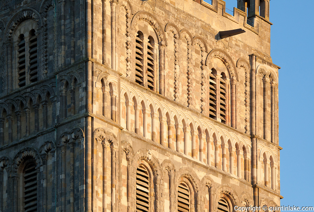 """Detail of south facing facade of Exterior of Tewkesbury tower Abbey  dating from 1150  rated """"probably the largest and finest Romanesque tower in England"""" by Sir Nikolaus Pevsner."""