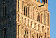 "Detail of south facing facade of Exterior of Tewkesbury tower Abbey  dating from 1150  rated ""probably the largest and finest Romanesque tower in England"" by Sir Nikolaus Pevsner."