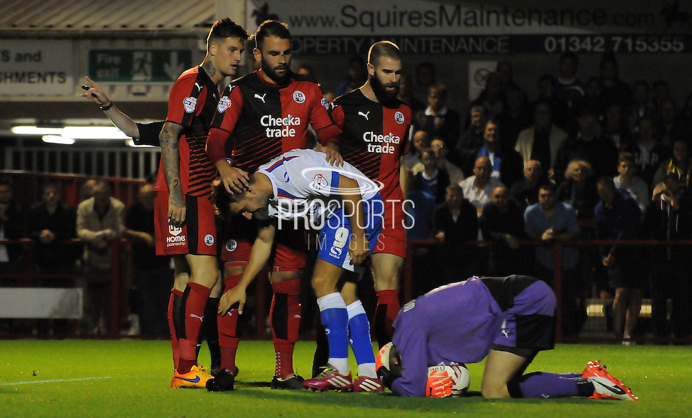 Freddie Woodman lies hurt after saving bravely at the feet of Matt Tubbs during the Sky Bet League 2 match between Crawley Town and Portsmouth at the Checkatrade.com Stadium, Crawley, England on 18 August 2015. Photo by Michael Hulf.