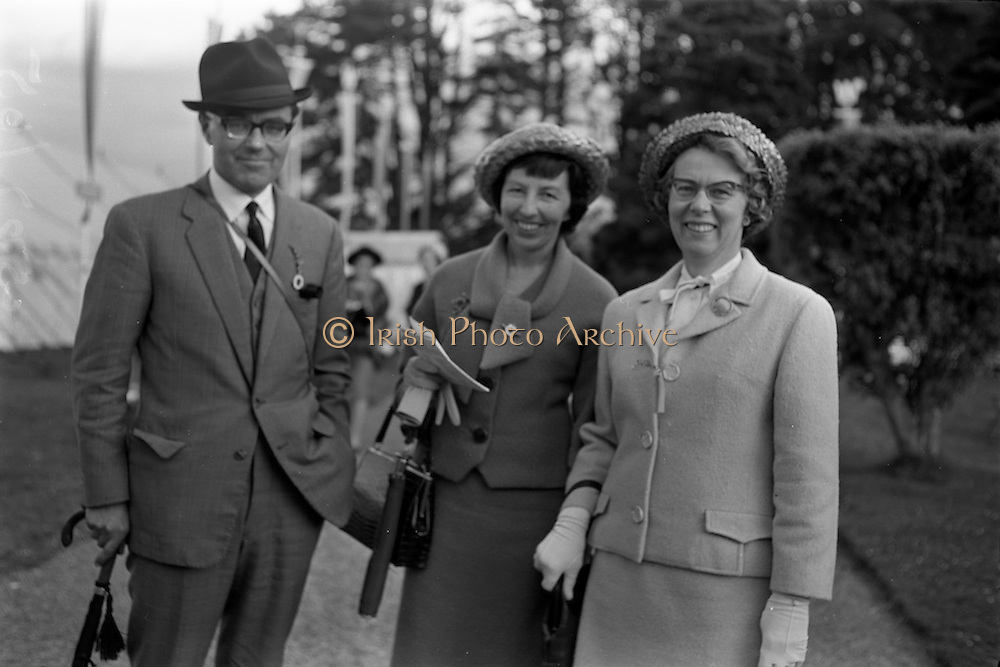 10/05/1965<br /> 05/10/1965<br /> 10 May 1965<br /> Left to right, Mr. and Mrs. V. Jackson with Mrs. K. H. Grove at the Leopardstown Races.