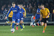 AFC Wimbledon striker Joe Pigott (39) dribbling and taking on Southend United midfielder Sam Mantom (18) during the EFL Sky Bet League 1 match between AFC Wimbledon and Southend United at the Cherry Red Records Stadium, Kingston, England on 1 January 2020.