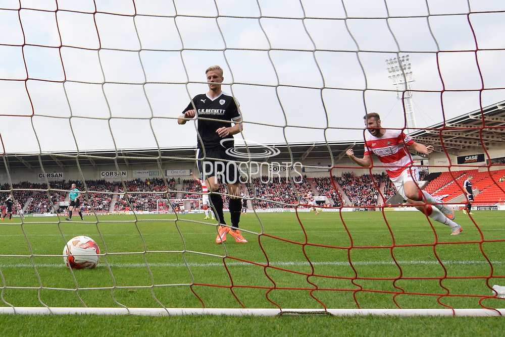 Andy Williams of Doncaster Rovers celebrates Richard Chaplow of Doncaster Rovers scoring for Doncaster to go 2-1 up during the Sky Bet League 1 match between Doncaster Rovers and Barnsley at the Keepmoat Stadium, Doncaster, England on 3 October 2015. Photo by Ian Lyall.