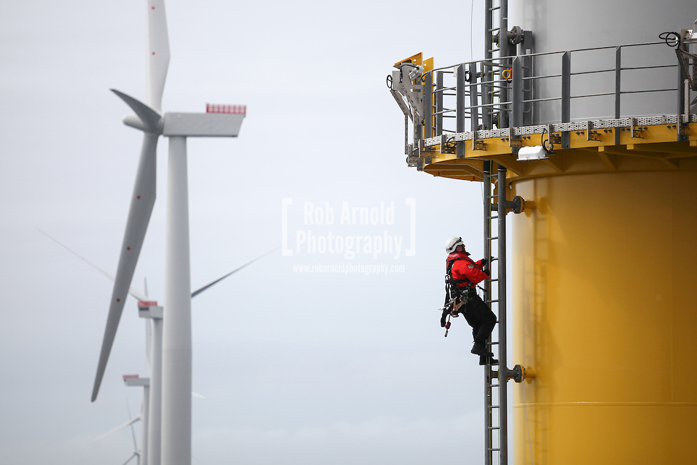 © Rob Arnold.  07/04/2014. North Wales, UK. A man climbing the ladder of a wind turbine whilst at work on the Gwynt y Môr Offshore Wind Farm. Photo credit : Rob Arnold