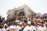 TUNIS, TUNISIA - 27 JULY 2013: Tunisian mourners gather in front of Mohamed Brahmi's house in Ilghazela district , before the start of his funeral in Tunis, Tunisia, on July 27th 2013.<br /> <br /> Tunisia, birthplace of the Arab Spring revolutionary movement, was plunged into a new political crisis on Thursday when assassins shot Mohamed Brahmi, 58, leader of the Arab nationalist People's Party, an opposition party leader outside his home in a hail of gunfire.