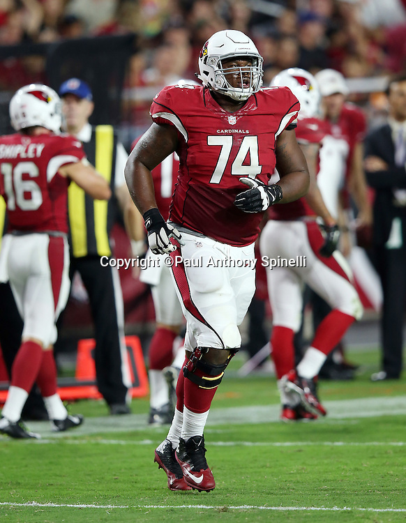 Arizona Cardinals offensive tackle D.J. Humphries (74) jogs onto the field during the 2015 NFL preseason football game against the Kansas City Chiefs on Saturday, Aug. 15, 2015 in Glendale, Ariz. The Chiefs won the game 34-19. (©Paul Anthony Spinelli)