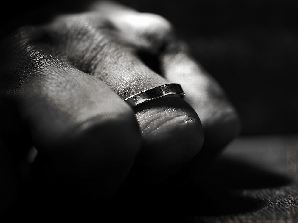 Finger wearing a ring