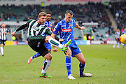 Plymouth Argyle's Ryan Brunt gets a cross in under pressure from Notts County's Haydn Hollis during the Sky Bet League 2 match between Plymouth Argyle and Notts County at Home Park, Plymouth, England on 27 February 2016. Photo by Graham Hunt.