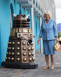 The Prince of Wales and The Duchess of Cornwall visit  the set of the BBC One drama series Doctor Who.<br /> In the picture - The Duchess of Cornwall meets a Dalek, Cardiff, Wales, Wednesday July 3rd, 2013.. Photo by i-Images