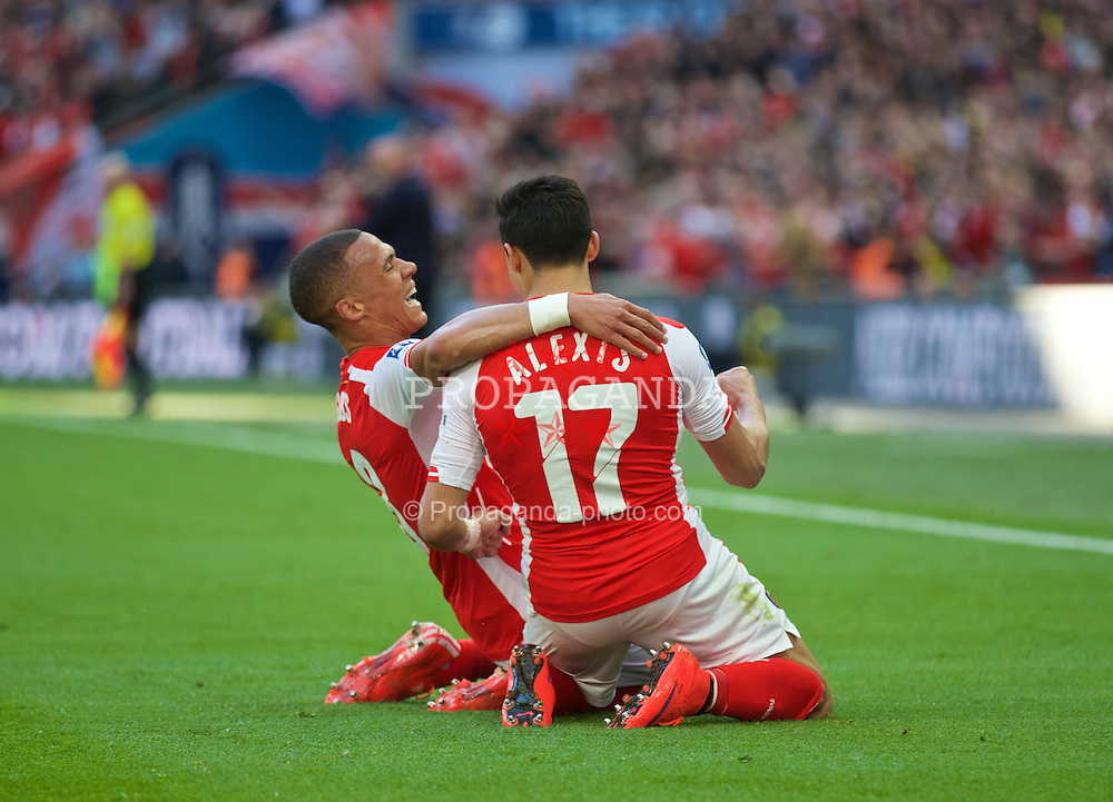 LONDON, ENGLAND - Saturday, April 18, 2015: Arsenal's Alexis Sanchez celebrates scoring the first goal against Reading with team-mate Kieran Gibbs during the FA Cup Semi-Final match at Wembley Stadium. (Pic by David Rawcliffe/Propaganda)