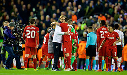 LIVERPOOL, ENGLAND - Thursday, March 10, 2016: Liverpool's manager Jürgen Klopp celebrates the 2-0 victory over Manchester United with Dejan Lovren after the UEFA Europa League Round of 16 1st Leg match at Anfield. (Pic by David Rawcliffe/Propaganda)