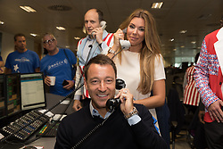 © Licensed to London News Pictures. 11/09/2018. London, UK.  John Terry with his wife at the 14th Annual BGC Charity Day held on the trading floor of BGC Partners in Canary Wharf, to raise money for charitable causes in commemoration of BGC's 658 colleagues and the 61 Eurobrokers employees lost on 9/11.  Photo credit: Vickie Flores/LNP