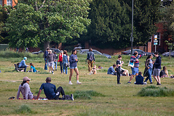 © Licensed to London News Pictures. 16/05/2020. London, UK. Busy scenes as members of the public relax in the sunshine on Wimbledon Common in South West London on the first weekend after the Government relaxed the law on lockdown to let people spend more time outside while following social distancing guidelines as weather experts predict a very warm week ahead. Photo credit: Alex Lentati/LNP