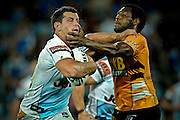 GOLD COAST, AUSTRALIA - SEPTEMBER 03:  Greg Bird of the Titans is tackled by Robert Lui during the round 26 NRL match between the Gold Coast Titans and the Wests Tigers at Skilled Park on September 3, 2010 on the Gold Coast, Australia.  (Photo by Matt Roberts/Getty Images)