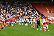Barnsley FC and Fulham FC walk out onto the pitch during the EFL Sky Bet Championship match between Barnsley and Fulham at Oakwell, Barnsley, England on 3 August 2019.