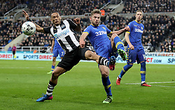 Leeds United's Charlie Taylor (right) and Newcastle United's Yoan Gouffran (left) battle for the ball during the Sky Bet Championship match at St James' Park, Newcastle.