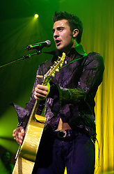 Darius, Plays Sheffield City Hall, Sunday 18th May 2003<br /> Darius Campbell, born Darius Campbell-Danesh, 19 August 1980, also known professionally either as Darius Danesh or Darius, is a Scottish platinum-selling singer-songwriter, a West End stage actor, an operatic baritone, an author, and an Ambassador for The Prince's Trust. He first gained fame in 2001 after appearing on the British talent competition Popstars. A year later he was voted to the finals of the TV talent show, Pop Idol. He turned down Simon Cowell's record deal, then signed with producer Steve Lillywhite.<br /> <br /> Image Copyright Paul David Drabble<br /> <br /> 18th May 2003