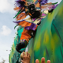 February 21, 2012; New Orleans, LA, USA; A member of The Krewe of Zulu hands a reveler a coconut as it rolled along the uptown New Orleans St. Charles Avenue parade route on Mardi Gras day. Mardi Gras is an annual celebration that ends at midnight with the start of the Catholic Lenten season which begins with Ash Wednesday and ends with Easter. Photo by: Derick E. Hingle