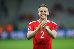 5LILLE, FRANCE - Friday, July 1, 2016: Wales' Chris Gunter applauds the supporters as he celebrates the 3-1 victory over Belgium at full time after the UEFA Euro 2016 Championship Quarter-Final match at the Stade Pierre Mauroy. (Pic by Paul Greenwood/Propaganda)