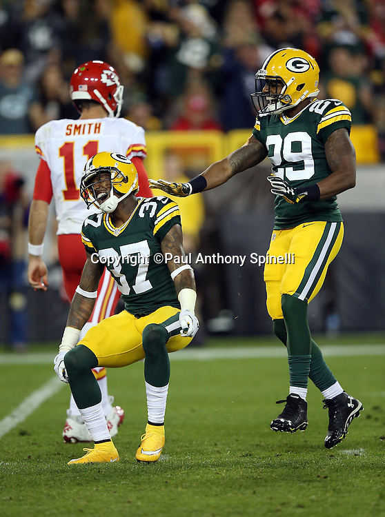 Green Bay Packers cornerback Casey Hayward (29) celebrates with Green Bay Packers cornerback Sam Shields (37) after Shields puts a big hit on Kansas City Chiefs wide receiver De'Anthony Thomas (13) on a second quarter play during the 2015 NFL week 3 regular season football game against the Kansas City Chiefs on Monday, Sept. 28, 2015 in Green Bay, Wis. The Packers won the game 38-28. (©Paul Anthony Spinelli)