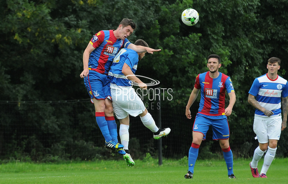 Connor Dymond heads clear the danger during the U21 Professional Development League match between U21 QPR and U21 Crystal Palace at the Loftus Road Stadium, London, England on 31 August 2015. Photo by Michael Hulf.