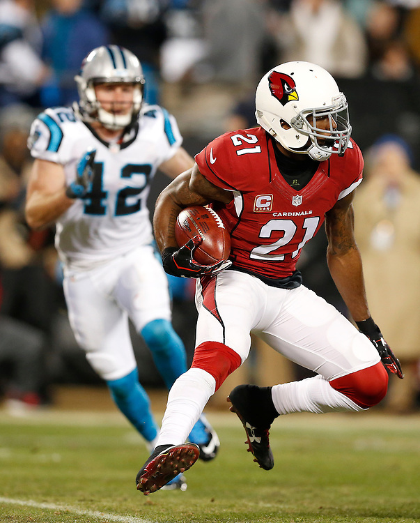 CHARLOTTE, NC - JAN 24:  Cornerback Patrick Petersen #21 of the Arizona Cardinals returns an interception during the NFC Championship game against the Carolina Panthers at Bank of America Stadium on January 24, 2016 in Charlotte, North Carolina.
