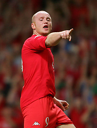 CARDIFF, WALES - Wednesday, September 8, 2004: Wales' John Hartson celebrates scoring against Northern Ireland during the Group Six World Cup Qualifier at the Millennium Stadium. (Pic by David Rawcliffe/Propaganda)