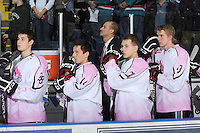 KELOWNA, CANADA, NOVEMBER 5: Austin Ferguson #28, Cody Chikie #14, Tyson Baillie #24 and Taner Moar #23 line up on the bench during the national anthem as the Portland Winterhawks visit the Kelowna Rockets  on November 5, 2011 at Prospera Place in Kelowna, British Columbia, Canada (Photo by Marissa Baecker/Shoot the Breeze) *** Local Caption ***