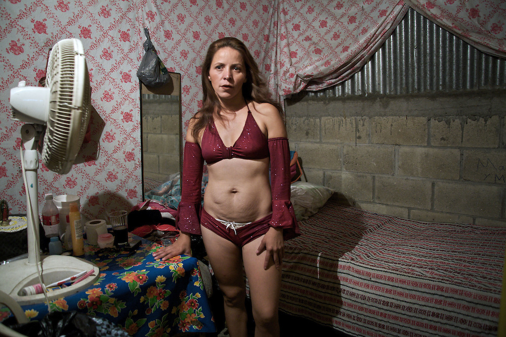 Charytín, 25 years from Guatemala. She is preparing to work in his room at the brothel, Frontera Comalapa, Chiapas.- Prostitution on Mexican Southern Border